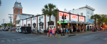 hemingway: KEY WEST, FLORIDA, USA - MAY 02, 2016: Sloppy Joes Bar in the twilight in Duval street in the center of Key West
