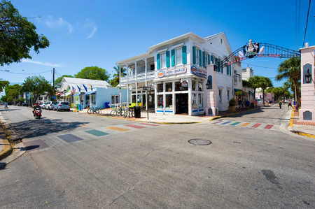 tourist attraction: KEY WEST, FLORIDA, USA - MAY 02, 2016: Typical Florida houses in Duval street in the center of Key West Editorial