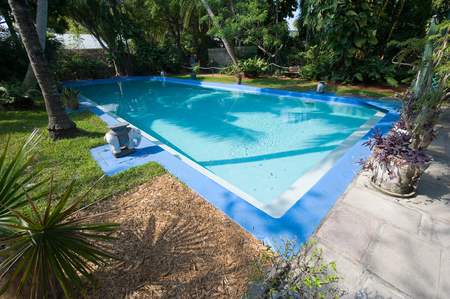 novelist: KEY WEST, FLORIDA, USA - MAY 03, 2016: Swimming pool in the garden of the Hemingway House in Key West in Florida.