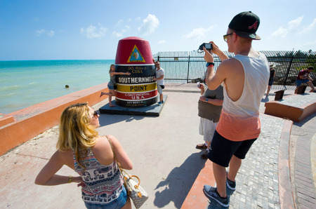 southernmost: KEY WEST, FLORIDA, USA - MAY 02, 2016: Tourists are making pictures at the southernmost point of the USA in Key West in Florida Editorial