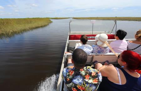 everglades: EVERGLADES, FLORIDA, USA - APRIL 30, 2016: Tourists on a boat tour through the Everglades swamp in Florida Editorial