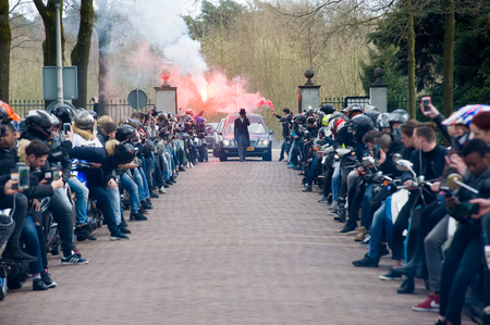 mortician: ENSCHEDE, THE NETHERLANDS - MARCH 17, 2017: Members of a motor pacing a lane during a funeral procession. It is a tribute Because one of Their members parished in a crash.