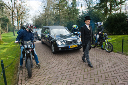 ENSCHEDE, THE NETHERLANDS - MARCH 17, 2017: Members of a motorgang making a lane during a funeral procession. It is a tribute because one of their members parished in a crash.