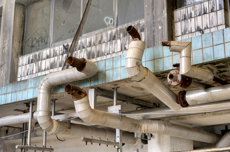 Interior of an old and abandoned milk factory Stock Photo