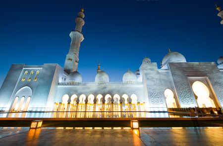 ABU DHABI, UNITED ARAB EMIRATES - DEC 31, 2017: Exterior of the Sheikh Zayed Mosque in Abu Dhabi in twilight. It is the largest mosque in the country. Editorial