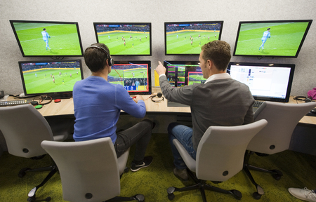 ZEIST, THE NETHERLANDS - NOV 30, 2018: VAR referee Bas Nijhuis (left) and his operator Mike van der Roest (right) working at the VAR center in the headquarters of the Dutch football association. Redactioneel