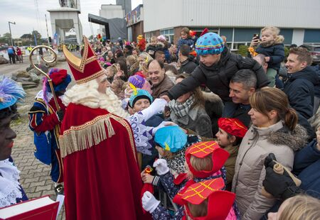 ENSCHEDE, THE NETHERLANDS - NOV 16, 2019: The dutch Santa Claus called 'Sinterklaas' is greeting the children after he has arrived on a boat in a dutch harbor Redactioneel