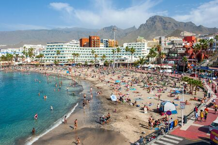 CANARY ISLAND TENERIFE, SPAIN - 26 DEC, 2019: Tourists are relaxing on playa la pinta puerto colon. A very popular beach near the city of San Eugenio.