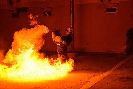 rehearse: Man in fire show after Firefighters training, Rehearse of firefighters from cooking.