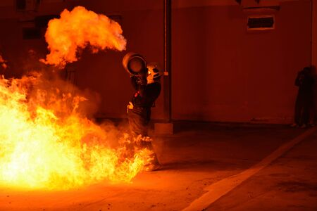 rehearse: Man in fire show after Firefighters training, Rehearse of firefighters from cooking.  Stock Photo