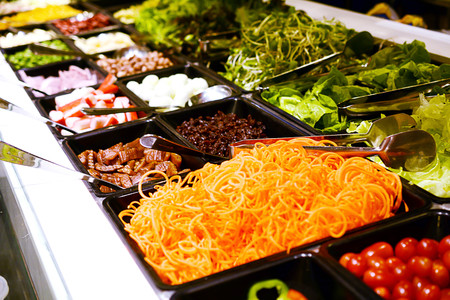Salad bar, A salad bar is a buffet-style table or counter at a restaurant or food market on which salad components are provided for customers to assemble their own salad