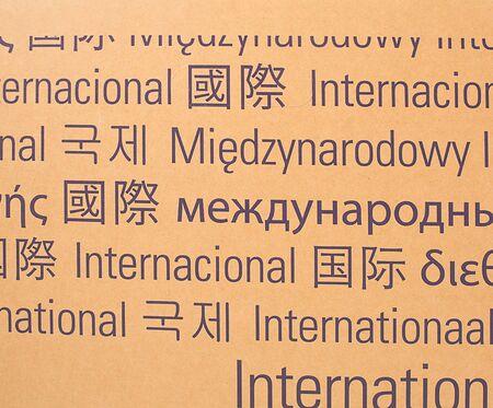 International Keyword Language Diversity on Shipping paper box Stock Photo