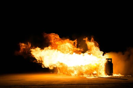 Fire from burning gas. Burning oil and the burning gas tank.