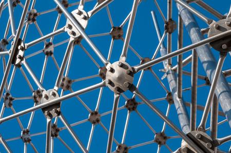 Steel spherical construction against a blue sky