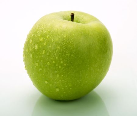A green apple with water drops