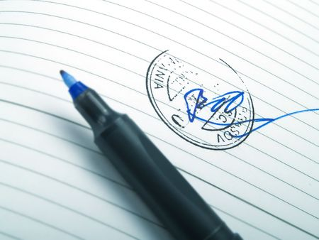 trustworthiness: A signature with a stamp and a blue pen Stock Photo