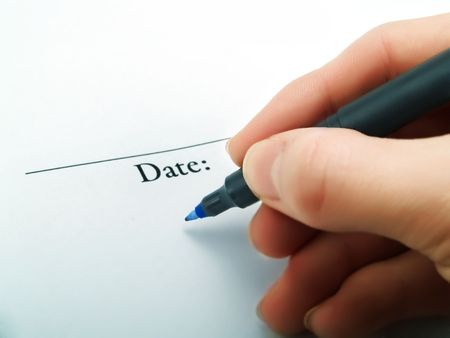 Writing the current date on a contract photo