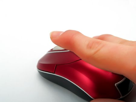 Clicking with a red optical mouse with wireless on pure white background