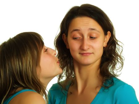 A blond pretty lady wants to kiss the other girl with brown hair