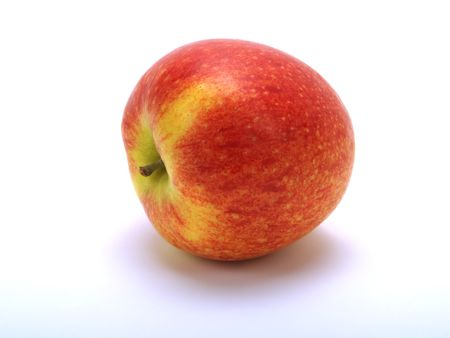 tumbled: A tumbled fresh red apple on white background