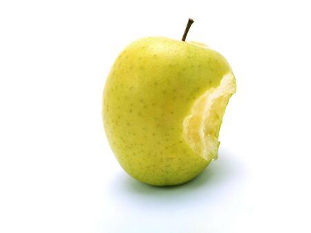 A bitten fresh green apple on white background photo