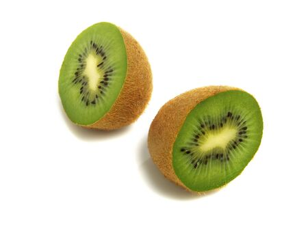 Two fresh halves kiwis isolated on white background Stock Photo