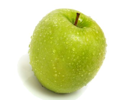 A single fresh ripe green apple with water drops and isolated on white background