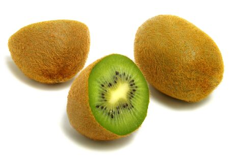 A group of cut and whole kiwis isolated on white background