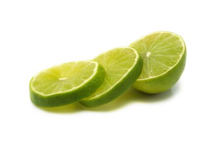 Sliced fresh lime isolated on white background