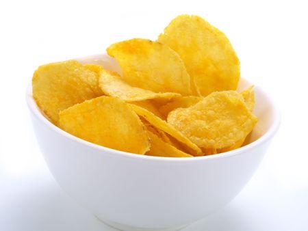 seasoned: Crispy potato chips in a white bowl