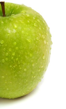 A half part of a single fresh ripe green apple with water drops and isolated on white background
