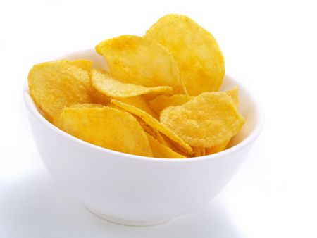 russet potato: Delicious potato chips in white bowl
