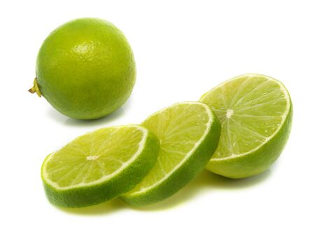 Sliced and whole fresh lime isolated on white background