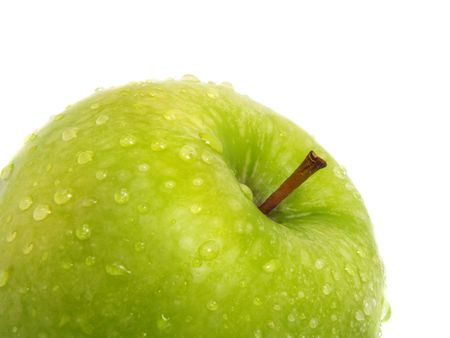 The top of a standing single fresh ripe green apple with water drops and isolated on white background Stock Photo