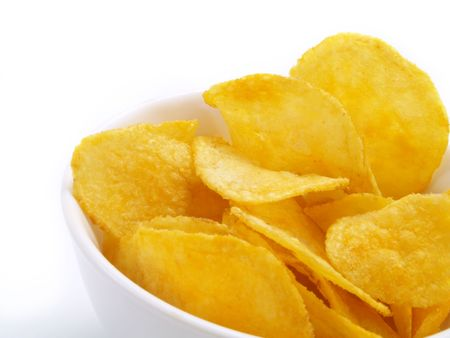 russet potato: Yummy potato chips in white bowl Stock Photo