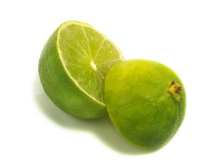 A fresh cut apart lime isolated on white background Stock Photo - 3332118