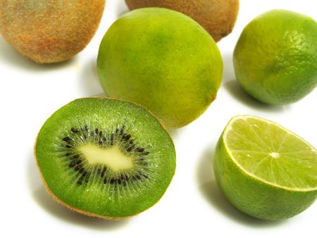 A groups of half and whole fresh kiwis and limes isolated on white background Stock Photo - 3332125