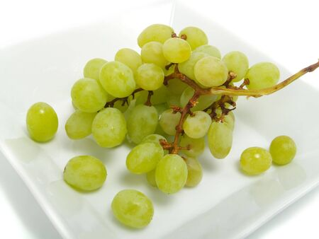 Fresh bunch of green grapes in white bowl and isolated on white background Stock Photo - 3359030