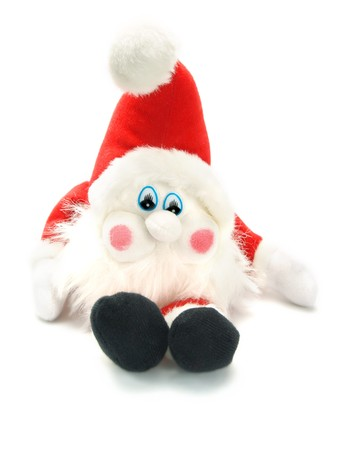 Closeup photo of a sweet stuffed Christmas Santa Claus toy sitting. Isolated on white. Stock Photo