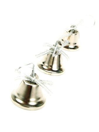 Closeup photo of a line of silver bells with nice ribbons as Christmas decoration. Isolated on white.
