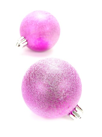 familiar: Closeup photo of two nice colorful purple Christmas decoration baubles. Isolated on white.