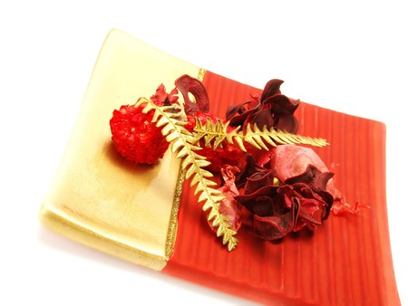 Closeup photo of a red, golden bowl decorated with nice Christmas ornaments: red and golden dried plants (flowers, roses, fern). Isolated on white. Stock Photo - 3976385