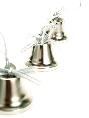 familiar: Closeup photo of a line of silver bells with nice ribbons as Christmas decoration. Isolated on white.