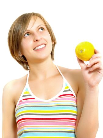 Portrait of an attractive Caucasian blond girl with a nice colorful striped summer dress who is smiling and she is holding a fresh lemon in her hand. Isolated on white. Stock Photo - 5089426