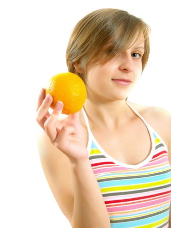 Portrait of a cute Caucasian blond girl with a nice colorful striped summer dress who is smiling and she is holding a fresh orange in her hand. Isolated on white. Stock Photo - 5149492