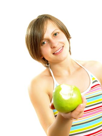 Portrait of an attractive Caucasian blond girl with a nice colorful striped dress who is smiling and she is holding a bitten fresh green apple in her hand.   Isolated on white.