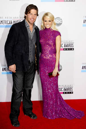 underwood: Carrie Underwood and Mike Fisher at the 40th Anniversary American Music Awards held at the Nokia Theatre L.A. Live in Los Angeles, United States, 181112.