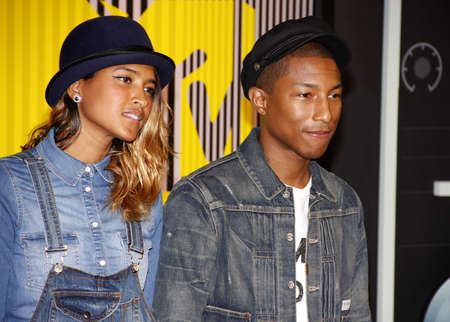 LOS ANGELES, CA - AUGUST 30, 2015: Pharrell Williams and Helen Lasichanh at the 2015 MTV Video Music Awards held at the Microsoft Theater in Los Angeles, USA on August 30, 2015. Stock Photo - 51217830