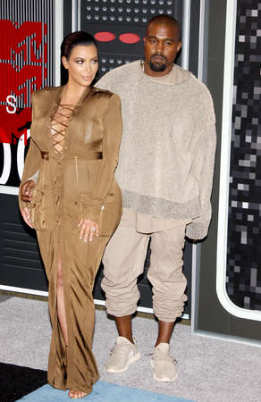 LOS ANGELES, CA - AUGUST 30, 2015: Kanye West and Kim Kardashian at the 2015 MTV Video Music Awards held at the Microsoft Theater in Los Angeles, USA on August 30, 2015. Editorial