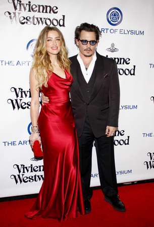 Amber Heard and Johnny Depp at the Art Of Elysiums 9th Annual Heaven Gala held at the 3LABS in Culver City, USA on January 9, 2016.